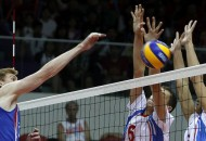 SINGAPORE, 22 Aug 2010 - Maxim Kulikov (L) of Russia spikes ball during the Boys Volleyball Preliminary match against Serbia at the Singapore 2010 Youth Olympic Games in Singapore, August 22, 2010. Russia won by 3-0.